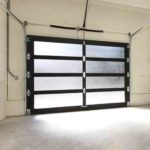 Modern two cars garage with screen doors.
