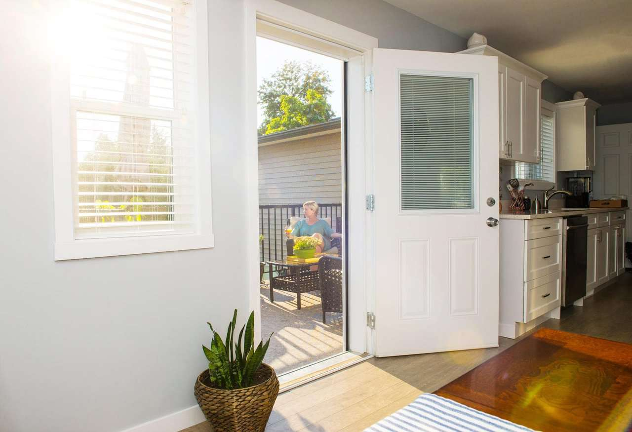 Improve your home by painting the house trim and doing window screen repair.
